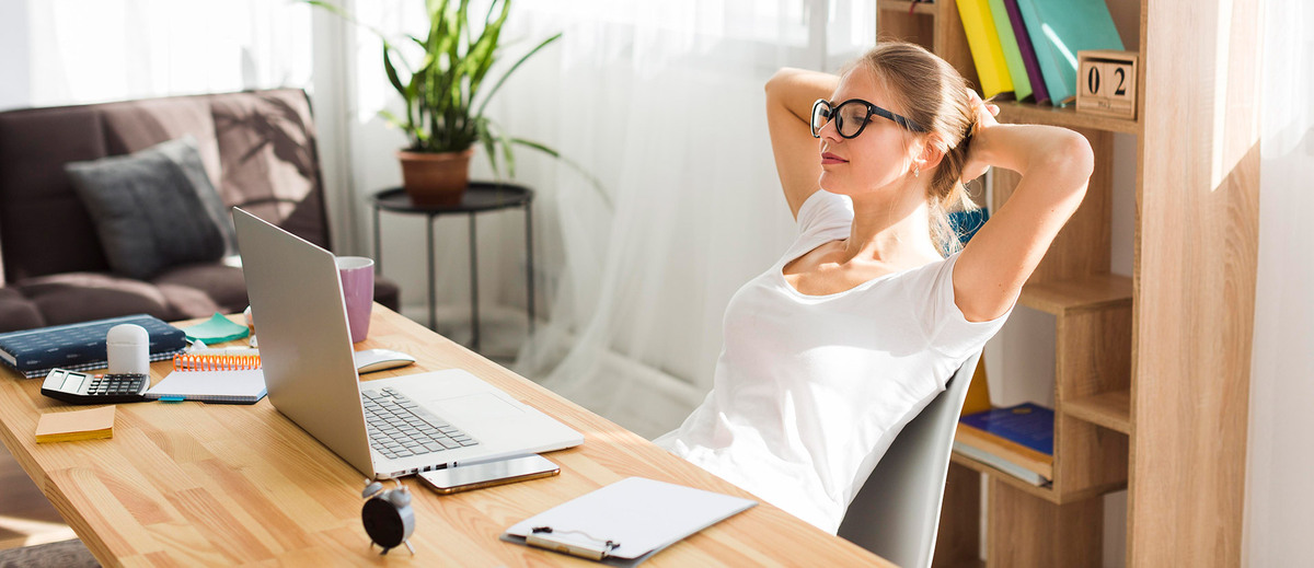 woman sitting laid back in a chair while working remotely