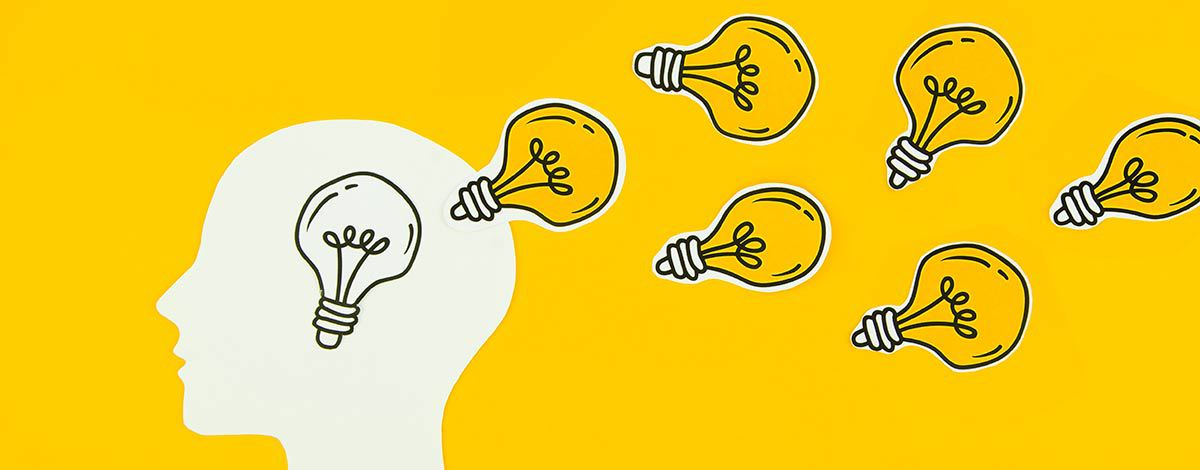 light bulbs coming out of a person's head signifying ideas