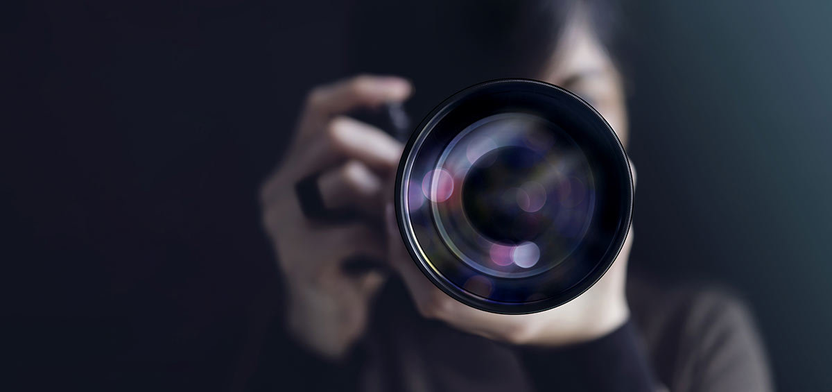 a woman filming herself with the camera being in focus